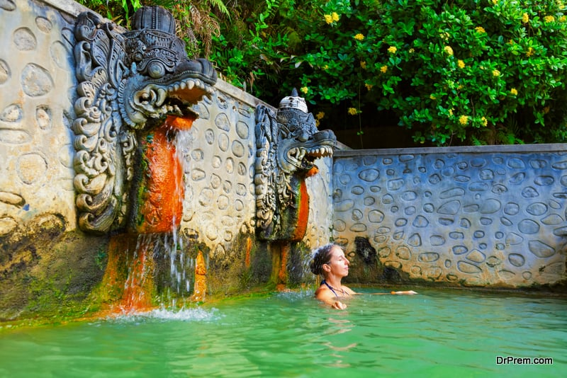 Woman in natural hot spring Air Panas Banjar on Bali