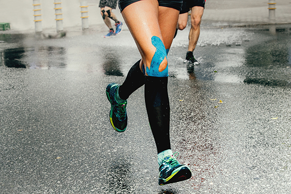 Cropped shot of runner with KT tape on knee